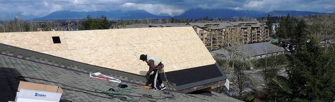 Roofers working on New Roof Construction at Yorkson Creek Condos, Langley BC