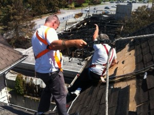 Surlang Roofers secure condo roof after Langley Fire