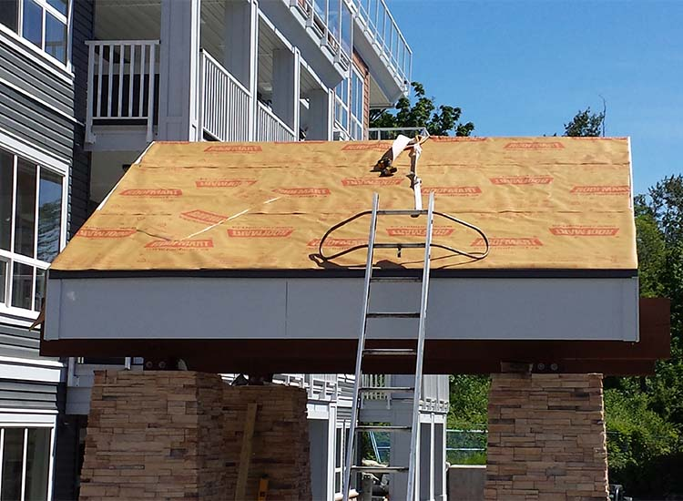 Re-Roofing using pro lock metal panels at Waterstone, Surrey BC