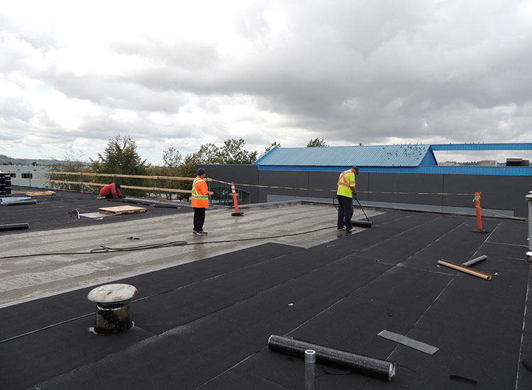 Surlang Roofers applying SBS on United Furniture Warehouse in Coquitlam, BC
