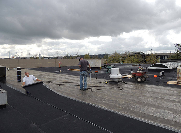 Surlang Roofers Torching SBS on United Furniture Warehouse in Coquitlam, BC